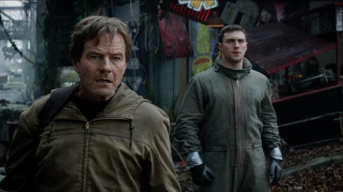 Bryan Cranston (à gauche) et Aaron Taylor-Johnson (à droite) contribuent à la construction des personnages par un jeu de qualité mais la profondeur apportée sera laissée de côté ensuite