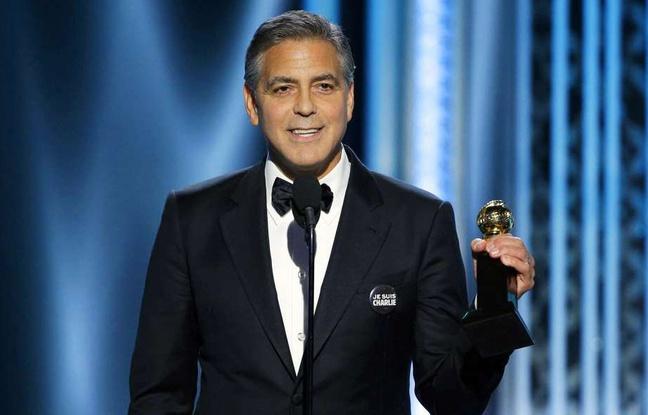 """George Clooney, arborant un badge """"Je suis Charlie"""", a tenu à rendre hommage aux victimes des attentats et à dire que """"nous ne marcherons pas dans la peur""""."""