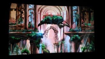 L'écran de la section Child of Light fait se succéder plusieurs décors animés du jeu.