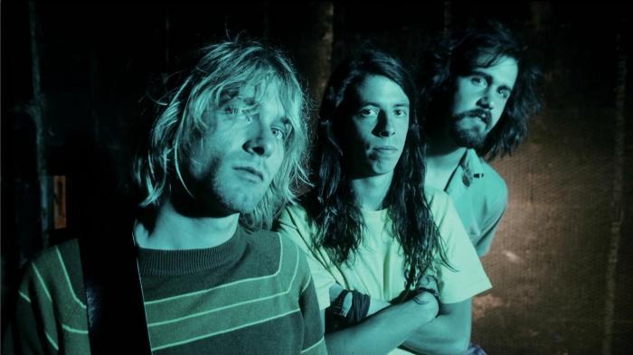 Nirvana sur une des photos promotionnelles de Nevermind en 1991. Dave Grohl (au centre) est le nouveau batteur du groupe.